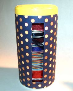 Ribbon Organizers out of wet wipe container.~ a ribbon storage solution  keeping ribbon spools visable and tidy.