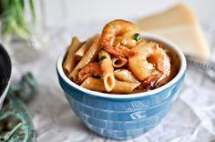 Spicy Parmesan Shrimp Skillet--shrimp, olive oil, parm cheese, garlic cloves, brown sugar, soy sauce, red pepper flakes, & penne.