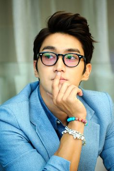 The epic hotness of Choi Siwon. And also I want these glasses for myself.