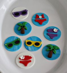 *Please check my shop announcements for my current production schedule: http://www.etsy.com/shop/parkersflourpatch?ref=si_shop ....................................................................................................................  This listing is for 12 handmade fondant beach themed toppers to decorate cupcakes, cookies or other sweet treats. You will receive a variety of bikini, palm tree and sunglasses toppers.  The toppers are approximately 2.5 inches in diameter…