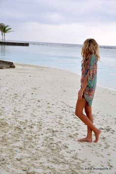 Pretty beach cover-up. Lovely curls also.