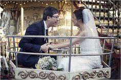 wedding couple on carousel | Image by Olivier Lalin of WeddingLight Photography