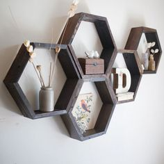 Plans for Hexagon Shelves Set of 5 Hexagon Shelves Honeycomb patterned hexagon shelves made from reclaimed piano wood. Set of 5 Hexagon Shelves Honeycomb patterned hexagon shelves made from reclaimed piano wood. Hexagon Wall Shelf, Honeycomb Shelves, Diy Room Decor, Bedroom Decor, Home Decor, Warm Bedroom, Bedroom Ideas, Reclaimed Wood Beds, Floating Glass Shelves
