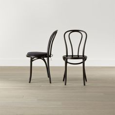 In 1859, Michael Thonet introduced the concept of bending wood with steam to design the iconic bentwood chair. Today, our bent beechwood Vienna dining chair is produced in one of the original Thonet factories in Europe. <NEWTAG/><ul><li>Bent beechwood frame and seat in black lacquer finish</li><li>Engineered wood seat</li><li>Polyester and foam cushion with 100 percent cotton twill cover and tie attachments (optional; sold separately)</li><li>Made in multiple countries</li></ul><br />