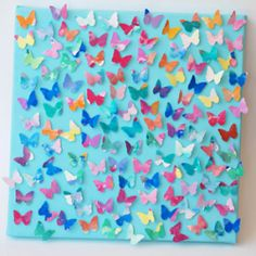 Could modify for a class art project.  Each child in charge of own butterfly and attach to a large canvas.