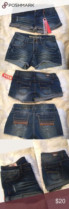 """Mossimo & 1st Kiss jean shorts bundle juniors 11 2 pair stretchy Denim shorts both size 11. Mossimo with Embroidered ribbon pocket details and 1st Kiss NWT braided trim. 1st k: 34"""" unstretched waist. 8.5"""" rise. 2"""" inseam. Mossimo: 32"""" unstretched waist. 8"""" rise. 3"""" inseam. Note: only 1st Kiss is NWT. Mossimo is gently preloved. Mossimo Supply Co Shorts Jean Shorts"""