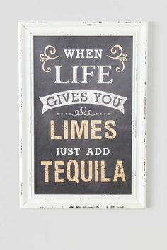 """When life gives you limes, just add tequila"" Hang this hilarious sign in your kitchen or bar area for a fun touch! White wood borders the chalk board body."