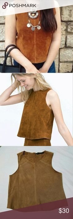 Zara Suede Leather Camel Sleeveless Crop Top Gorgeous Zara Basic camel suede cropped top with suede stiching detail along the bottom hem. Has some staining, a visit to the dry cleaners would probably take care of it, but also wouldn't be very visible when worn. Still lovely and has tons of life left! Offers welcome, price flexible on this top! Zara Tops Crop Tops