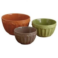 """Three grooved ceramic mixing bowls with a raised oak leaf border.  Product: Small, medium and large mixing bowlsConstruction Material: CeramicColor: Orange, brown and greenDimensions: Small: 3.75"""" H x 7"""" DiameterMedium: 4.75"""" H x 8.75"""" DiameterLarge: 5.5"""" H x 10"""" Diameter"""