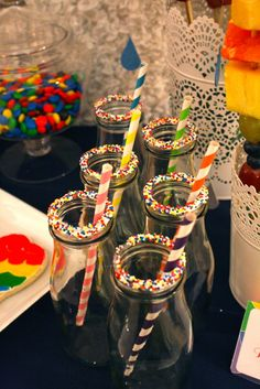 Milk Bottles with sprinkles at a Hot Air Balloon Party #hotairballoon #partydrinks
