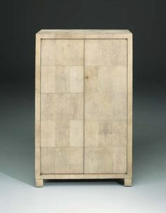 A Shagreen Cabinet  Jean-Michel Frank  Veneered with shagreen panels, shelf-lined interior, original key  44¼in. (112.5cm.) high; 27¾in. (70.5cm.) wide; 13½in. (34.5cm.) deep  Stamped J.M. FRANK CHANAUX & Co. and numbered 8334 with cypher