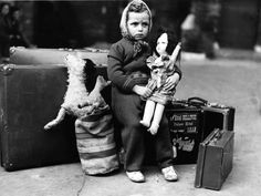 Little girl waiting to be evacuated from London in 1940.  Poor little thing.  I hope it turned out OK for her and her family...