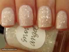 Snow angel nails, super cute, probably a nightmare to get off all that glitter