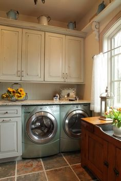 Nice Laundry Room! Linen enamel with distressing and sand through. Also like the contrasting stained sink area. Granite counter top a nice +