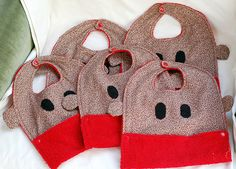 Sock monkey bibs... party favors the wee ones??