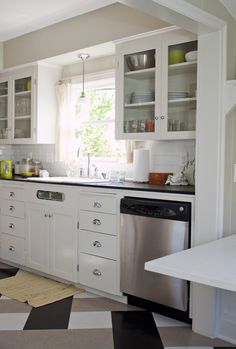 Period galley kitchen, white cabinets, paperstone countertops, VCT floors