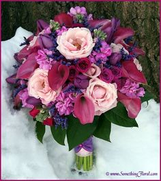 Hand-tied, round, bridal bouquet in shades of pink, mauve, lavender, violet, and purple. Featuring roses, calla lilies, tulips, stock, hydrangea, sweetheart roses, and lavender. Designed by Something Spectacular / Something Floral (Warren, MI). Photo: Urban Fire Studio #pink #mauve #purple #lavender #violet #roses #calla #lilies #tulips
