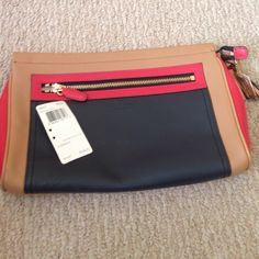 NWT Authentic Coach Clutch Brand new with tags and never used! Gorgeous leather clutch bag Coach Bags Clutches & Wristlets