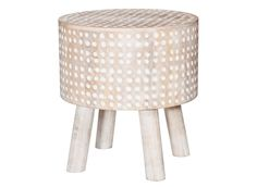 A foot stool with driftwood legs and dot-patterned cover from the Threshold spring-summer 2016 colle