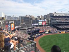 The outfield, bleachers and the huge scoreboard at Yankee Stadium