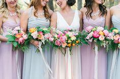 Colorful bridal bouquets, plus mis-matched plastel bridesmaid dresses.  Photo: Fat Orange Cat.
