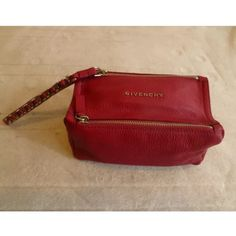 $670 Authentic Givenchy Pandora dark red wristlet Givenchy Pandora red wristlet, brand new.  Bought from Barneys and never used, comes with dust cover, booklet, and original tag.  Retail $670.  Saving up for a new bag, so need to sell!  Please feel free to make offers with the offer button.  Thanks! Givenchy Bags Clutches & Wristlets