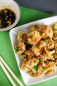 Crispy Thai peanut cauliflower wings with agave soy dipping sauce - cauliflower florets in a red curry-infused batter are breaded, then baked.