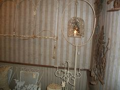 Birdcage stand in an antique mall booth