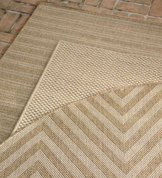Laurel Indoor and Outdoor Seagrass Look Rug In Neutral Patterns..Under kitchen table?