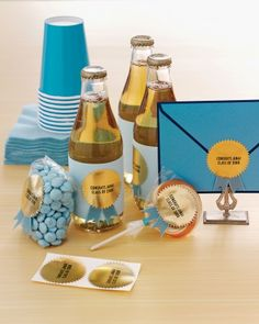 Put a celebratory seal on graduation-party invitations, and then continue the theme -- and the color scheme -- by decorating party wares such as soda bottles and bags of candy. The embellishments can be made by printing a congratulatory message on gold-medallion notary stickers and placing small notched ribbons behind them before affixing.