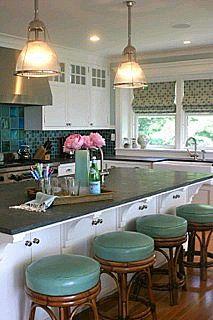 Nice kitchen. (I always love the roman shades...)