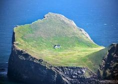 Really lonely house on one of the isles of Vestmannaeyjar.  Shot through a plane window.  Elliðaey, Vestmannaeyjar, Iceland. (Link)