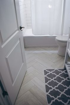 Bathroom Decor Guest Bathroom Renovation Update: Finding Beauty in the Progress Guest Bathroom Ideas - Gray and White Design - Herringbone Floor Design - White washed wood-looking tiles Guest Bathrooms, Small Bathroom, Bathroom Things, Bathroom Showers, Bathroom Colors, Herringbone Tile Floors, Wood Tiles, Wood Floor Bathroom, White Wood Floors