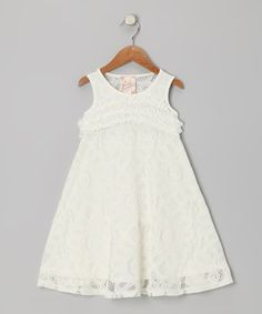 This dress has a tea length and charming lace overlay for an heirloom-quality look and feel that transcend the trends.