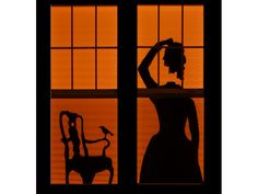 Turn the windows of your home into a dramatic Halloween luminary with these simple paper-cut silhouettes.