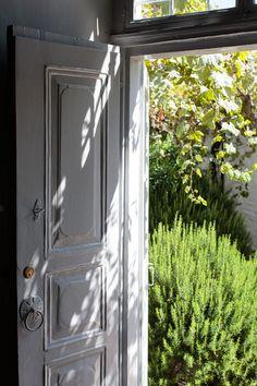 Mediterranean Traditional Garden A grouping of rosemary shrubs outside a front door Grey Gardens, Outdoor Gardens, Portal, Mediterranean Home Decor, Garden Photos, Door Knockers, Plein Air, Garden Inspiration, Beautiful Homes