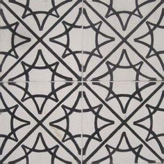 Art deco cement tiles, white and black with 8 pointed stars and circles