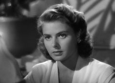 Ingrid Bergman. I love her hair here. Her fringe is a top half-wave reverse roll. I like her back hair having fluff and being curled like it is.