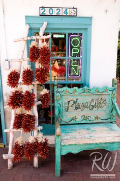 Southwestern Turquoise Window, Bench and Red Chili Peppers at Old Town Plaza, Albuquerque, New Mexico
