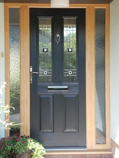 Image result for black composite door with white frame