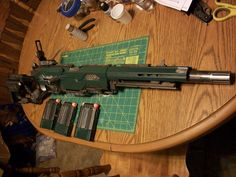 Finished this Warhammer Imperial guardsman Las Rifle. Started with the Nerf Longstrike took off the flip sight it came with and used the more military look of the recon flip sight. the gun was . Cosplay Weapons, Weapons Guns, Airsoft Guns, Guns And Ammo, Steampunk Weapons, Steampunk Diy, Modified Nerf Guns, Outdoor Tv Antenna, Nerf Mod