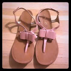 Blush Bow Sandals  Adorable patent leather bow sandals. Some stains on the back of the heel as pictured. These run small as I usually wear a size 8.  Unisa Shoes Sandals