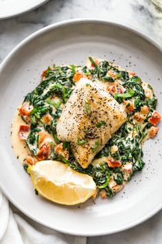 meals to make -:This easy Fish Florentine recipe, made with a pan seared firm white fish served on a creamy bed of spinach feels like something you would order out in a fancy restaurant! Fish And Spinach Recipe, Spinach Recipes, Baby Spinach, Best Fish Recipes, Seafood Recipes, Healthy Recipes, Fast Recipes, Healthy White Fish Recipes, Swai Recipes