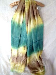 A beautiful, cool and soft multi coloured silk scarf. A lovely delicate and smooth feeling on the skin. 100% pure Silk, an excellent scarf for your collection.