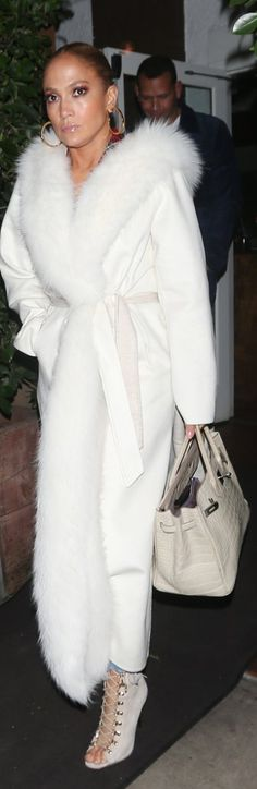 Who made Jennifer Lopez's white wrap coat, lace up shoes, and tote handbag? | OutfitID