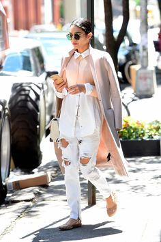 If you like to mix things up, make like Hudgens and offset a preppy look on top (re: tailored blouse and coat worn on the shoulders) with ultra-distressed white denim.   - MarieClaire.com