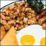 From the American Assorted Breakfast Recipe Collection. Every breakfast is better with some potatoes on this side.  And every potato is better some peppers, onions and garlic.