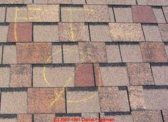 hail damaged roof showing roof inspectors chalk markings