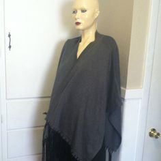 NWT gray Calvin Klein poncho This is a size large Calvin Klein gray with black fringe wrap top. It does not have arm holes, it is made to fit over top body and wrap to fit in front. Retail value is $99.50. It is NWT and comes from a smoke free home. Calvin Klein Sweaters Shrugs & Ponchos