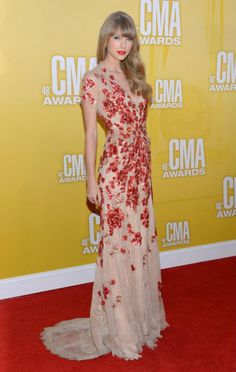 Taylor Swift looks stunning and statuesque in a nude Jenny Packham gown with red appliqués. Packham also happens to be one of Kate Middleton's go-to designers.